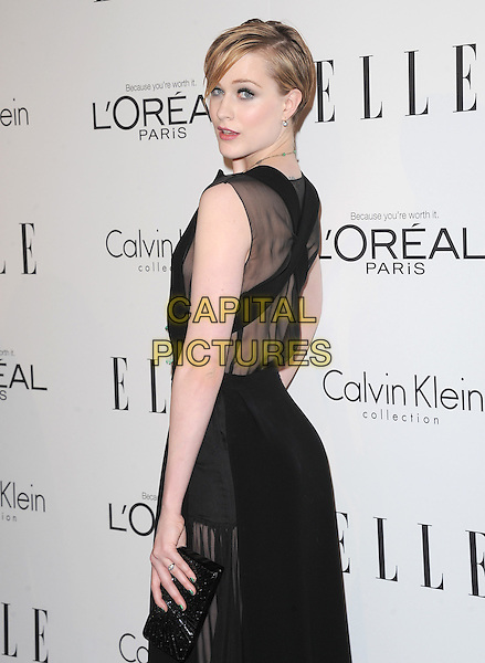Evan Rachel Wood.18th Annual ELLE Women in Hollywood celebration held at The Four Seasons in Beverly Hills, California, USA..October 17th, 2011.half length black sleeveless necklace sheer dress side looking over shoulder clutch bag.CAP/RKE/DVS.©DVS/RockinExposures/Capital Pictures.
