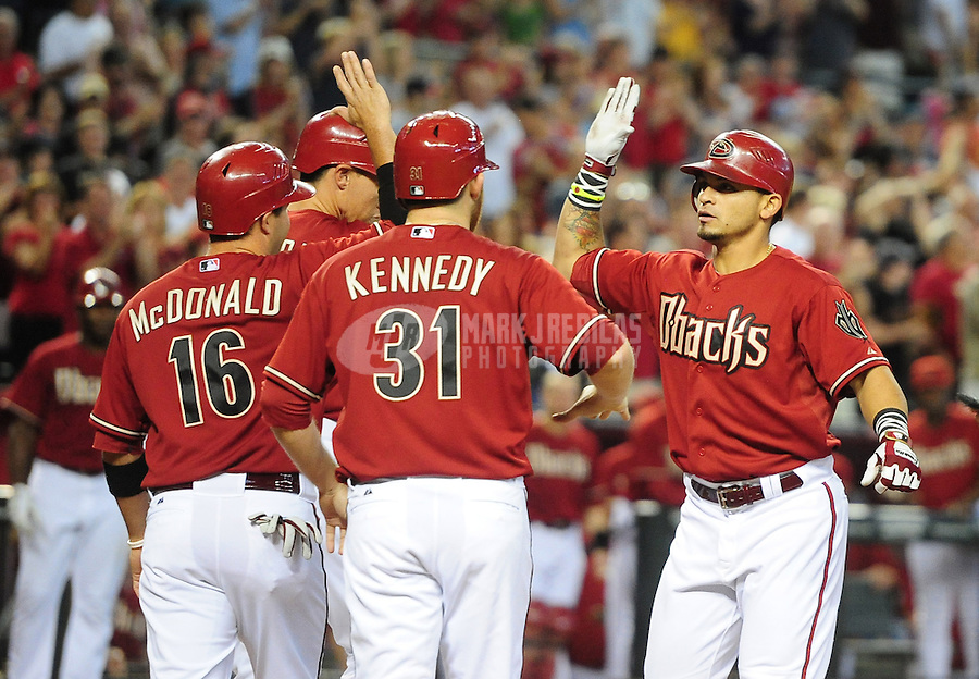 Apr. 22, 2012; Phoenix, AZ, USA; Arizona Diamondbacks batter Gerardo Parra (right) celebrates with teammates after hitting a grand slam in the second inning against the Atlanta Braves at Chase Field. Mandatory Credit: Mark J. Rebilas-