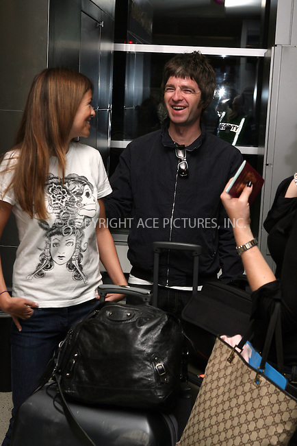 WWW.ACEPIXS.COM.................EXCLUSIVE COVERAGE - PLEASE PHONE FOR RATES**....New York City, September 17 2006....Oasis Member Noel Gallagher arrives in JFK Airport in New York City with Sara McDonald. There was a moment of confusing whilst their transport was located by their assistant, which left the couple standing about in the terminal.....Please byline: PHILIP VAUGHAN/ACEPIXS.COM....For information please contact Philip Vaughan:..tel: 212 243 8787 or 646 769 0430..e-mail: info@acepixs.com..website: www.acepixs.com