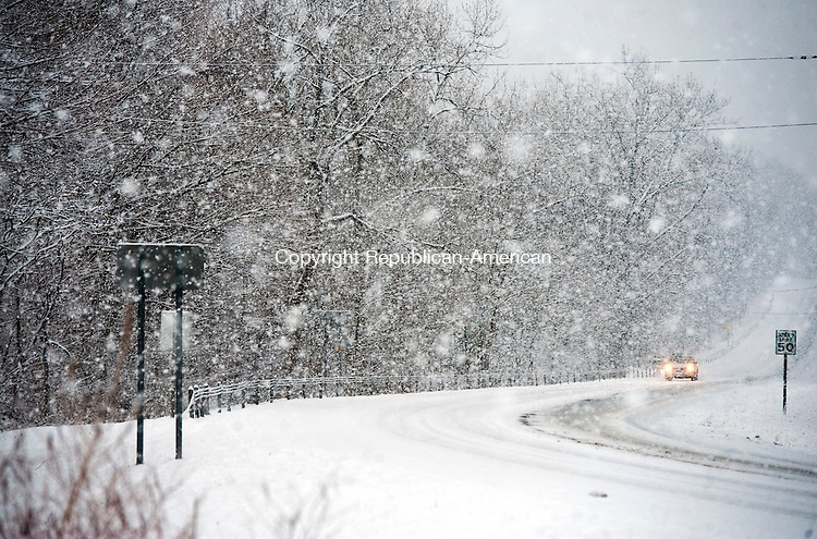 NORFOLK,  CT-122916JS11--While most of the state received only rain from Thursday's storm, part Norfolk saw heavy snowfall and accumulation. Drivers traveling along Route 44 in Norfolk drove slow and cautiously. <br /> Jim Shannon Republican-American