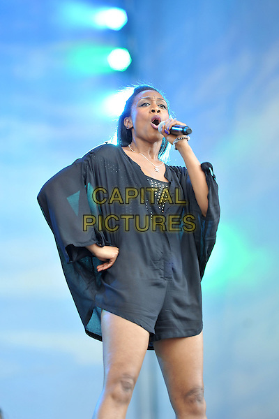 Beverley Knight.At BBC Radio 2 Live in Hyde Park, London, England..September 11th, 2011.stage concert live gig performance music half length black playsuit cape sleeves shorts hand on hip singing .CAP/MAR.© Martin Harris/Capital Pictures.