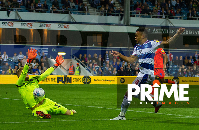 Millwall's goalkeeper Ben Amos saving QPR Jordan Cousins shot during the Sky Bet Championship match between Queens Park Rangers and Millwall at Loftus Road Stadium, London, England on 19 September 2018. Photo by Andrew Aleksiejczuk / PRiME Media Images.