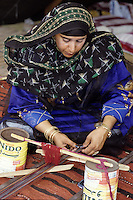 Masirah, Oman, Arabian Peninsula, Middle East - Omani Woman from Masirah Weaving a Belt.