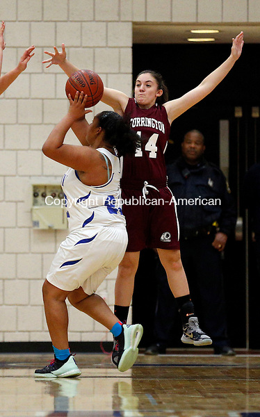 Waterbury, CT- 08 January 2016-010816CM08-  Torrington's  Sidnee Kovall defends blocks the shot of Crosby's Mariah Machado  during their NVL matchup in Waterbury on Friday.    Christopher Massa Republican-American