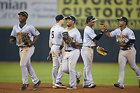(L-R) Josh Stowers (21), Oliver Dunn (8), cs15n\, Oswald Peraza (5), and Frederick Cuevas (1) celebrate their win over the Hickory Crawdads at L.P. Frans Stadium on August 10, 2019 in Hickory, North Carolina. The RiverDogs defeated the Crawdads 10-9. (Brian Westerholt/Four Seam Images)