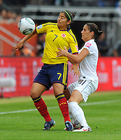 Alex Krieger (r) of team USA Catalina Usme of team Columbia during the FIFA Women's World Cup at the FIFA Stadium in Sinsheim, Germany on July 2nd, 2011.