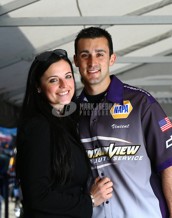 Feb 7, 2014; Pomona, CA, USA; NHRA pro stock driver Vincent Nobile poses for a portrait with girlfriend Eileen Atkinson during qualifying for the Winternationals at Auto Club Raceway at Pomona. Mandatory Credit: Mark J. Rebilas-