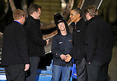 United States President Barack Obama (center right) shakes hands with Melissa Peters (C) as he tours Tower Tech Systems, Inc., a manufacturer of utility-scale wind towers and monopiles for on- and off-shore wind development,  with executive Paul Smith (center left) and other executives in Manitowoc, Wisconsin on Wednesday, January 26, 2011. President Obama, Vice President Joe Biden and other members of the President's Cabinet traveled across the country Wednesday to highlight the administration's efforts to rebuild the American economy.    .Credit: Brian Kersey / Pool via CNP