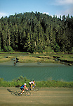 Mountain bikers along Big River in Mendocino, California