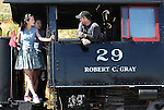 Charlie Cross, with the V&T Railroad, talks with Miss Chinese Cosmos contestants, Shanyi Yang, left, and Wei Guo during the group's tour of Virginia City, Nev., on Tuesday, Sept. 27, 2011..Photo by Cathleen Allison