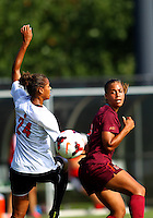WINSTON-SALEM, NORTH CAROLINA - August 30, 2013:<br />  Rachel Melhado (24) of Louisville University clashes with Jazmine Reeves (5) of Virginia Tech during a match at the Wake Forest Invitational tournament at Wake Forest University on August 30. The game ended in a 1-1 tie.