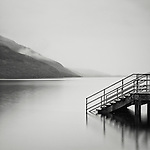 Steps leading into lake at Loch Lomond, Highlands, Scotland, UK