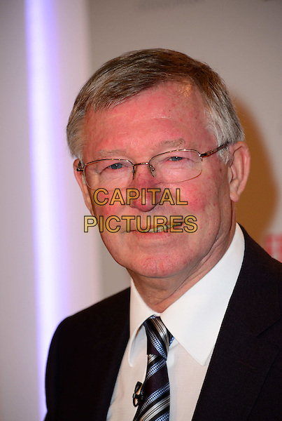 Alex Ferguson attends a photocall and press conference to promote his new autobiography - My Autobiography, Institute Of Directors, London, England.<br /> 22nd October 2013<br /> headshot portrait book black suit tie white shirt glasses <br /> CAP/BF<br /> &copy;Bob Fidgeon/Capital Pictures