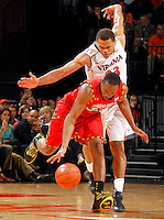 Maryland guard/forward Dez Wells (32) drives through Virginia guard Justin Anderson (23) during the game Sunday in Charlottesville, VA. Photo/Andrew Shurtleff