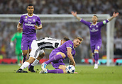 June 3rd 2017, National Stadium of Wales , Wales; UEFA Champions League Final, Juventus FC versus Real Madrid; Toni Kroos of Real Madrid and Paulo Dybala of Juventus battle for possession during the match