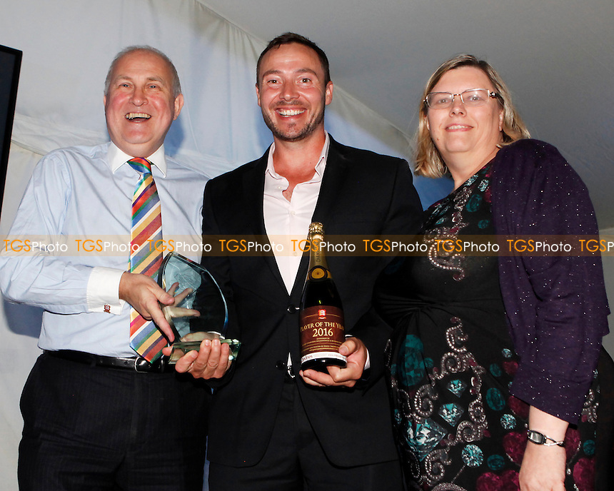 Graham Napier receives the Devines Essex Player of the year award from Clive and Alison Purdy during the Essex CCC 2016 Awards Evening at the Essex County Ground on 29th September 2016