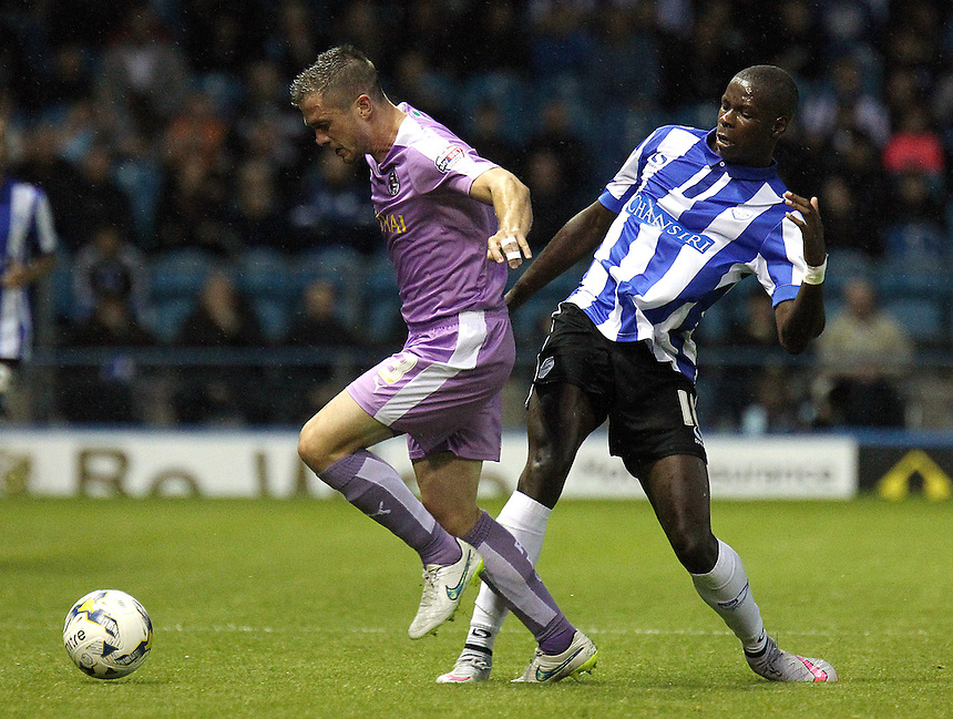 Reading's Andrew Taylor under pressure from Sheffield Wednesday's Lucas Joao<br /> <br /> Photographer Rich Linley/CameraSport<br /> <br /> Football - The Football League Sky Bet Championship - Sheffield Wednesday v Reading - Wednesday 19th August 2015 - Hillsborough - Sheffield<br /> <br /> &copy; CameraSport - 43 Linden Ave. Countesthorpe. Leicester. England. LE8 5PG - Tel: +44 (0) 116 277 4147 - admin@camerasport.com - www.camerasport.com