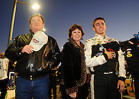 Apr 16, 2009; Avondale, AZ, USA; NASCAR Camping World Series West driver Austin Dillon (right) with car owner Richard Childress (left) and wife Judy Childress prior to the Jimmie Johnson Foundation 150 at Phoenix International Raceway. Mandatory Credit: Mark J. Rebilas-