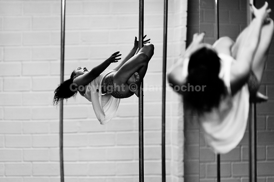 Carolina Echavarria, a young Colombian pole dancer, practices pole dance in Academia Pin Up, a dance studio in Medellín, Colombia, 25 February 2016. Pole dance, a performance combining sport with art and merging dance with acrobatics on a vertical pole, has reached wide popularity in Latin America in the last decade. With dance and physical attraction being a natural way of expression for many Latinas, thousands of women take pole dancing classes in gyms and dance studios, as a form of fitness and social entertainment.