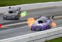 May 20, 2017; Topeka, KS, USA; NHRA funny car driver Jack Beckman (right) alongside Del Worsham during qualifying for the Heartland Nationals at Heartland Park Topeka. Mandatory Credit: Mark J. Rebilas-USA TODAY Sports