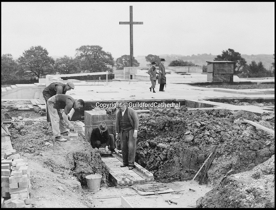 BNPS.co.uk (01202 558833)<br /> Pic: GuildfordCathedral/BNPS<br /> <br /> Work started on the foundations in 1936.<br /> <br /> Bad omens..<br /> <br /> One of Britains great cathedral's could be closed down if an emergency appeal for &pound;1.3 million is not successful by the end of August.<br /> <br /> Historic Guildford cathedral, where cult horror film The Omen was filmed, is facing closure because its ceiling is laced with asbestos.<br /> <br /> The 10,000sq ft ceiling of Guildford Cathedral was sprayed with a special acoustic plaster made from the deadly mineral in a bid to improve the sound quality when it was built in the 1960s.<br /> <br /> Fifty years on the ceiling has started to crumble forcing church bosses to launch an appeal to raise &pound;7 million pounds to pay for its restoration.<br /> <br /> They say that if the money can't be raised they will have no choice but to close its doors for good - the first British cathedral ever to do so.<br /> <br /> To add further pressure to the campaign, they have to raise 1.3 million pounds by the end of August in order to qualify for a Heritage Lottery Fund.<br /> <br /> More than 200,000 people paid two shillings and sixpence - the equivalent of 12.5 pence today - to buy a brick when the price of building materials shot up after World War II.
