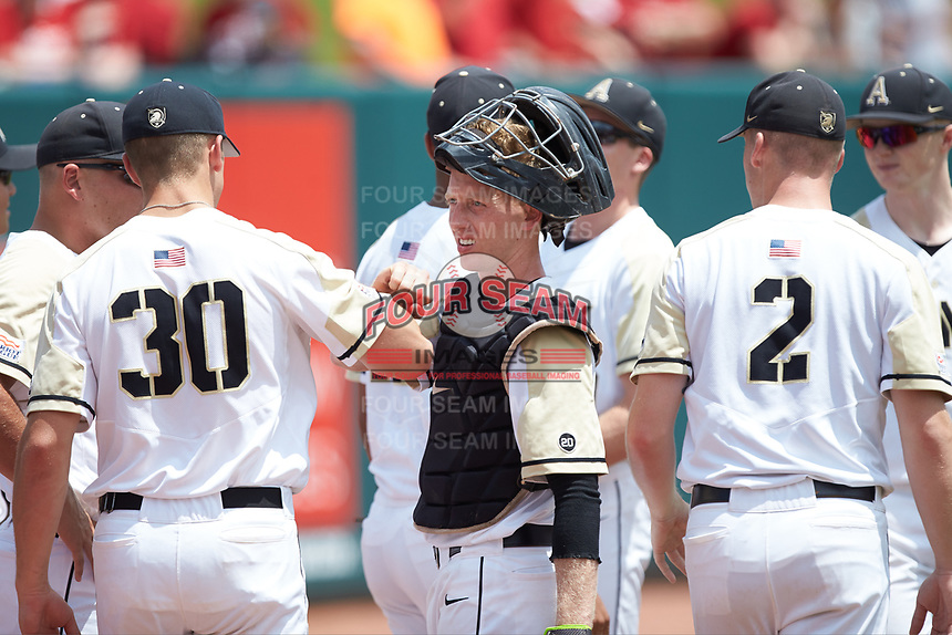 Army Black Knights catcher Jon Rosoff (7) huddles with his teammates prior to the game against the North Carolina State Wolfpack at Doak Field at Dail Park on June 3, 2018 in Raleigh, North Carolina. The Wolfpack defeated the Black Knights 11-1. (Brian Westerholt/Four Seam Images)