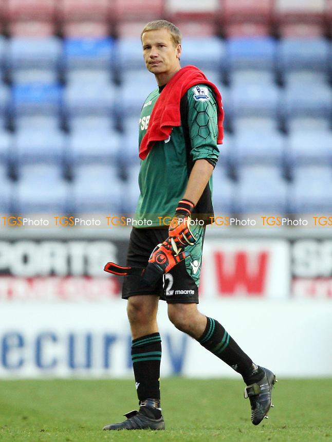 Jussi Jaaskelainen of West Ham looks dejected at the end of the game - Wigan Athletic vs West Ham United, Barclays Premier League at the DW Stadium, Wigan - 27/10/12 - MANDATORY CREDIT: Rob Newell/TGSPHOTO - Self billing applies where appropriate - 0845 094 6026 - contact@tgsphoto.co.uk - NO UNPAID USE.