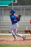GCL Mets second baseman Sebastian Espino (60) follows through on a swing during a game against the GCL Cardinals on August 6, 2018 at Roger Dean Chevrolet Stadium in Jupiter, Florida.  GCL Cardinals defeated GCL Mets 6-3.  (Mike Janes/Four Seam Images)