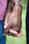 Elderly couple holding hands.  MR
