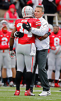 Ohio State Buckeyes running back Carlos Hyde (34) hugs Ohio State Buckeyes head coach Urban Meyer during senior day before the start of their game against Indiana Hoosiers at Ohio Stadium in Columbus, Ohio on November 23, 2013.  (Dispatch photo by Kyle Robertson)