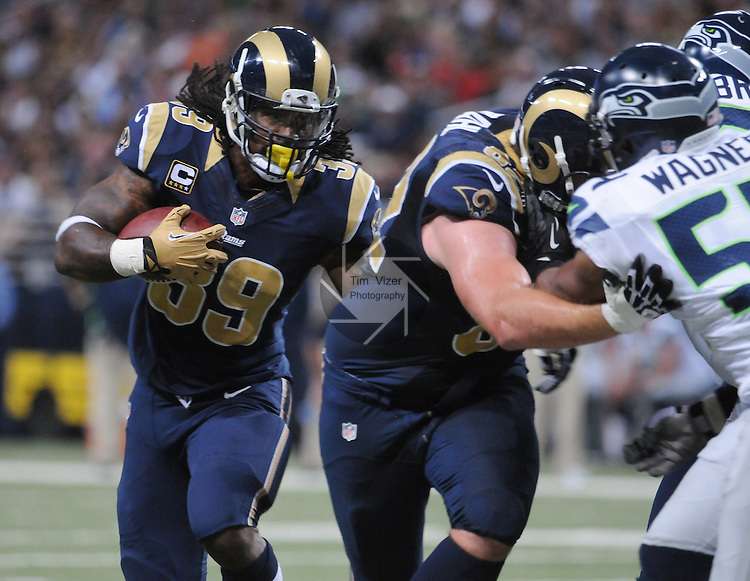 Football - NFL- Seattle Seahawks at St. Louis Rams.St. Louis Rams running back Steven Jackson (39) runs behind defenders in the second quarter at the Edward Jones Dome in St. Louis.  The Rams defeated the Seahawks, 19-13.