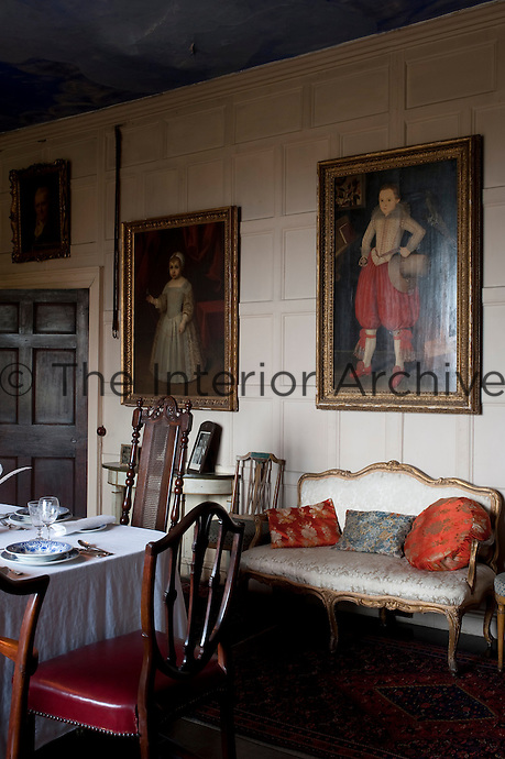 The painted panelling in the dining room is a departure from the dark oak wood that clads the rest of the house