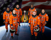 Houston, TX - (FILE) -- Attired in training versions of their shuttle launch and entry suits, these six astronauts take a break from training to pose for the STS-129 crew portrait on July 14, 2009. Pictured on the front row are astronauts Charlie Hobaugh (left), commander; and Barry Wilmore, pilot. From the left (back row) are astronauts Leland Melvin, Mike Foreman, Robert Satcher and Randy Bresnik, all mission specialists.   STS-129 is scheduled for launch on Monday, November 16, 2009 at 2:28 p.m. EST..Credit: NASA via CNP