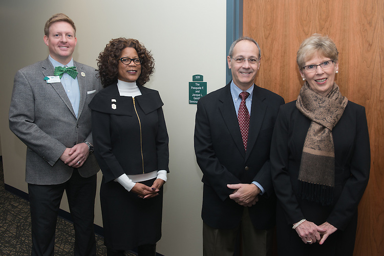 Pasquale and Jacque Gentile, right, along with Tim Binegar and Dean Renee Middleton, left, stand beside the new seminar room on the third floor of the newly renovated McCracken Hall on January 27, 2017.