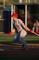AZL Reds catcher Stuart Turner (32) follows through on his swing in a rehab assignment during an Arizona League game against the AZL Cubs 2 at Sloan Park on June 18, 2018 in Mesa, Arizona. AZL Cubs 2 defeated the AZL Reds 4-3. (Zachary Lucy/Four Seam Images)