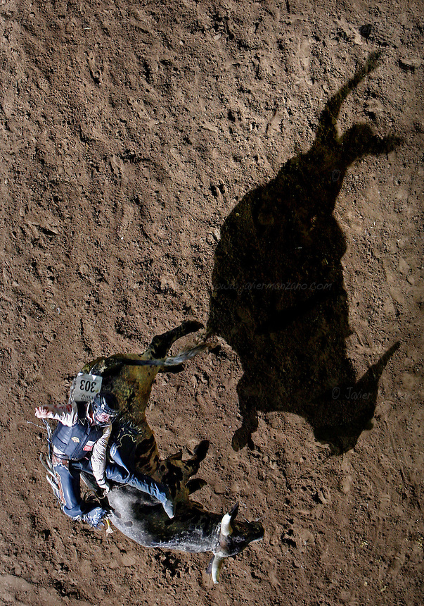 Colin Mc Taggart (cq) from Las Vegas, NV holds on as he struggles to stay on his bull at the Bull Riding event at the National Western Rodeo Finals in the Denver Coliseum on Sunday, January 27, 2008..(JAVIER MANZANO / ROCKY MOUNTAIN NEWS).Colin Mc Taggart (cq) .......