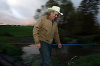 Farmer Joel Salatin crosses a creek at the Polyface Farm October 20, 2006 in Staunton, Va. ...Photo by Andrew B. Shurtleff, Freelance. farmer