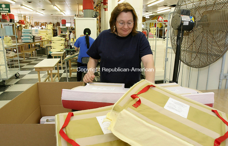 TORRINGTON, CT-09 May 2005-050905TK03  Denise McLellan, at the final inspection point of closely view airplane seating cushion before being shipped to a final assembly location.   Tom Kabelka staff photo (final inspection, Denise McLellan, Franklin Products)CQ