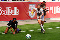 HARRISON, NJ - SEPTEMBER 29: Marisa Viggiano #23 of the Orlando Pride gets past Imani Dorsey #28 of Sky Blue FC during a game between Orlando Pride and Sky Blue FC at Red Bull Arena on September 29, 2019 in Harrison, New Jersey.