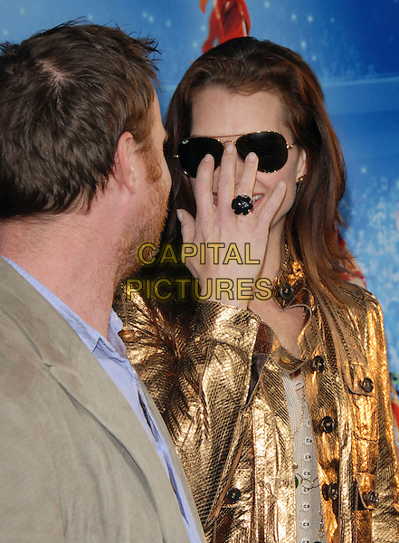 "CHRIS HENCHY & BROOKE SHIELDS.Attends The Paramount Pictures L.A. Premiere of ""Blades of Glory"" held at The Graumann's Chinese Theatre in Hollywood, California, USA. .March 28th, 2007.half length blue top gold jacket  sunglasses shades ring married husband wife .CAP/DVS.©Debbie VanStory/Capital Pictures"