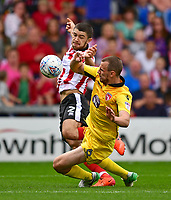 Lincoln City's Sean Long vies for possession with Morecambe's Dean Winnard<br /> <br /> Photographer Chris Vaughan/CameraSport<br /> <br /> The EFL Sky Bet League Two - Lincoln City v Morecambe - Saturday August 12th 2017 - Sincil Bank - Lincoln<br /> <br /> World Copyright &copy; 2017 CameraSport. All rights reserved. 43 Linden Ave. Countesthorpe. Leicester. England. LE8 5PG - Tel: +44 (0) 116 277 4147 - admin@camerasport.com - www.camerasport.com