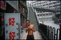 "Wanzhou, China, August 2003.Many old or ressourceless people fall ""through the net"" and become homeless as thousands of buildings are destroyed along 700 km of the Yangtze Kiang river because of the 3 Gorges Dam project.."