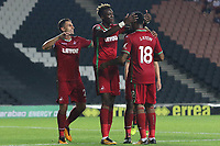 Tammy Abraham of Swansea City celebrates scoring his sides third goal of the match with Leroy For and Jordan Ayew during the Carabao Cup Second Round match between MK Dons and Swansea City at StadiumMK, Milton Keynes, England, UK. 22 August 2017