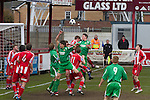Altrincham 2 Worcester City 0, 23/03/2013. Moss Lane, Blue Square Bet North. The home team defending a corner during the first-half of the the Blue Square Bet North fixture between Altrincham (in red) and Worcester City at Moss Lane, Altrincham. The home team won the match 2-0 watched by 777 spectators on a day when most non-League football in England was cancelled due to adverse weather. Altrincham were historically one of the major English non-League teams but have never been promoted to the Football League. Photo by Colin McPherson.