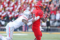 College Park, MD - November 12, 2016: Maryland Terrapins wide receiver Teldrick Morgan (19) is pushed out of bounds by a Ohio State Buckeyes defender during game between Ohio St. and Maryland at  Capital One Field at Maryland Stadium in College Park, MD.  (Photo by Elliott Brown/Media Images International)