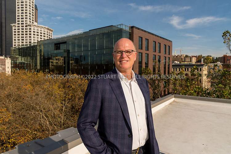11/4/2016-- Seattle, WA, USA<br /> <br /> Bill LaPatra, a partner at Mithun Architects, in front of the new Weyerhaeuser's headquarters he designed in Seattle.<br /> <br /> Weyerhaeuser&rsquo;s new Seattle headquarters in Pioneer Square, designed by architect Bill LaPatra, a partner at Mithun Architects, a firm well-known for its emphasis on sustainability.<br /> <br /> The building is unusual, because it is almost self-effacing, with the front door opening onto a park-courtyard area, with the building almost hidden behind a line of mature trees. Despite its quiet appearance, this is headquarters for Weyerhaeuser, a major corporate employer.<br /> <br /> Photograph by Stuart Isett. &copy;2016 Stuart Isett. All rights reserved.