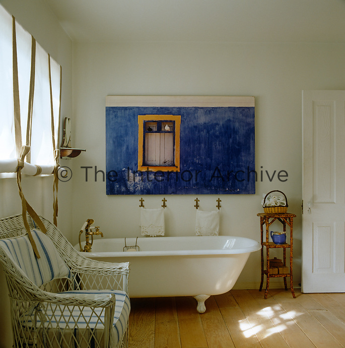 In this bathroom a large aluminium-mounted photograph has been hung directly above the bath creating a stunning accent of colour