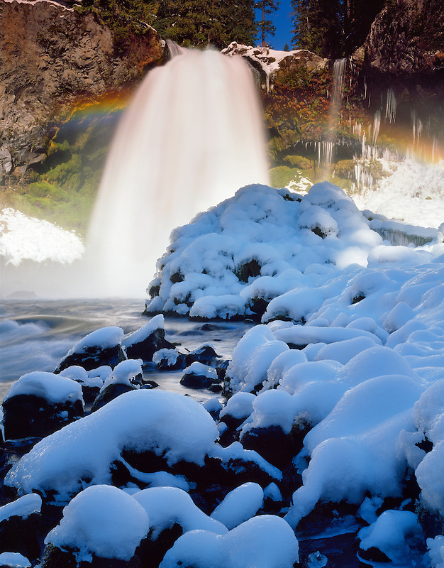Sahalie Falls with snow, ice and rainbow. Willamette National Forest. Oregon.