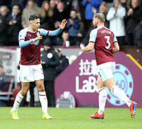 Burnley's Dwight McNeil (left) celebrates with team-mate Charlie Taylor after scoring his side's equalising goal to make the score 1-1<br /> <br /> Photographer Rich Linley/CameraSport<br /> <br /> The Premier League - Burnley v Leicester City - Saturday 16th March 2019 - Turf Moor - Burnley<br /> <br /> World Copyright © 2019 CameraSport. All rights reserved. 43 Linden Ave. Countesthorpe. Leicester. England. LE8 5PG - Tel: +44 (0) 116 277 4147 - admin@camerasport.com - www.camerasport.com
