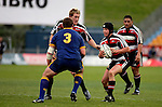 Blair Feeney considers his options as he is confronted by Nigel Hall during the Air NZ Cup game between Counties Manukau & Otago played at Mt Smart Stadium,Auckland on the 29th of July 2006. Otago won 23 - 19.